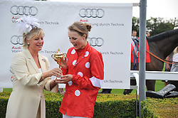 The COUNTESS OF MARCH presents the Magnolia Cup to EDIE CAMPBELL at the 3rd day of the 2011 Glorious Goodwood Racing Festival - Ladies Day at Goodwood Racecourse, West Sussex on 28th July 2011.