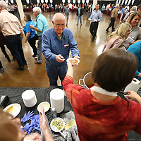 Adam Robison | BUY AT PHOTOS.DJOURNAL.COM<br /> Jimmy King, of Booneville, is handed his bowl of Beef soup by Ursula Garner at the Simply Sweet serving station at the Salvation Army Empty Bowls Luncheon Wednesday at Building V of the Tupelo Furniture Market.