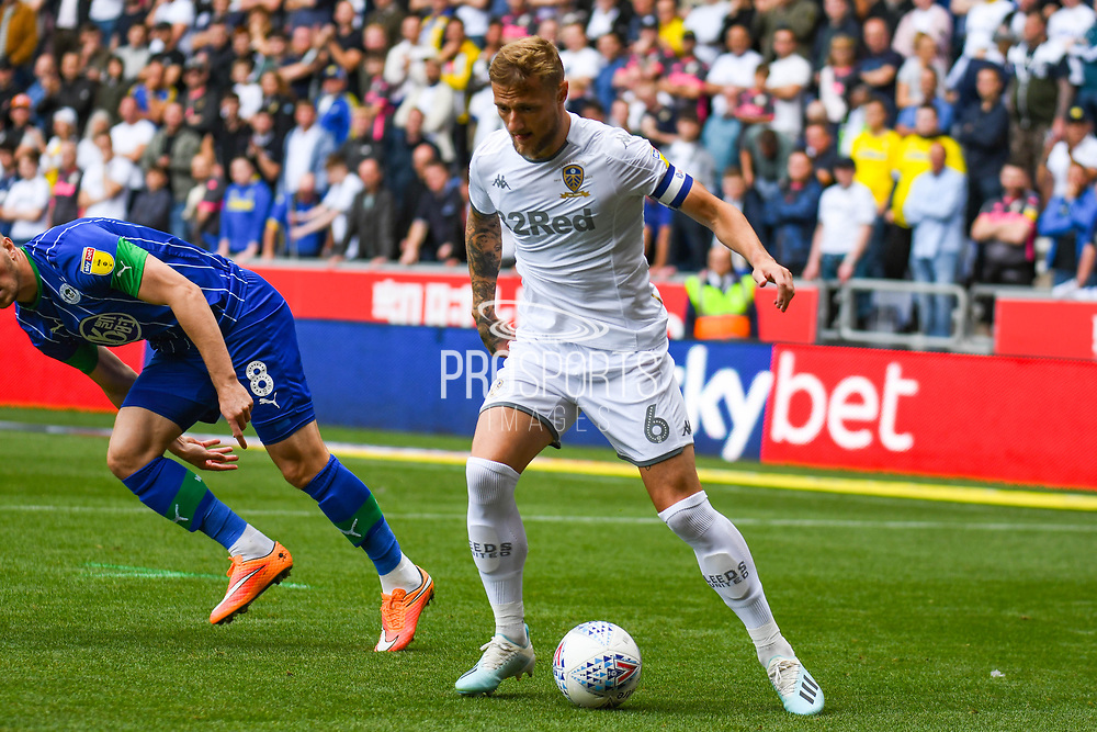 Leeds United defender Liam Cooper (6) in action Leeds United defender Liam Cooper (6) in action during the EFL Sky Bet Championship match between Wigan Athletic and Leeds United at the DW Stadium, Wigan, England on 17 August 2019.
