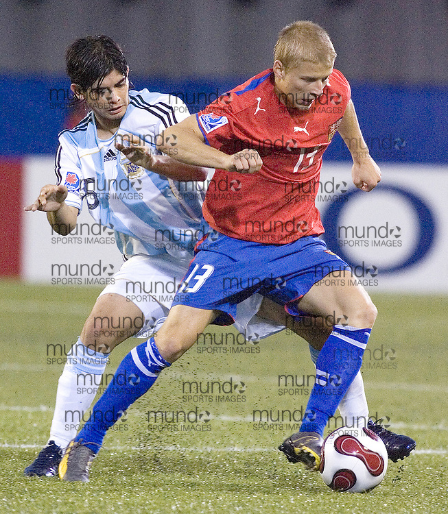 30 June 2007 (Ottawa) -- The Czech Republic (CZE) versus Argentina (ARG) group stage game in the FIFA U-20 World Cup Canada 2007. The game ended with a 0-0 draw...Tomas Micola of the Czech Republic holds off Ever Banega of Argentina...Photo credit Sean Burges/Mundo Sport Images.