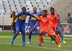 Cape Town City defender Thamsanqa Mkhize and Polokwane City midfielder  Vusimusi Mngomezulu in action against Polokwane City in an MTN8 quarter-final match at the Cape Town Stadium on August 12, 2017 in Cape Town, South Africa.