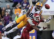 LSU reciever Jarvis Landry catches a pass over Arkansas defender DJ Dean late in the fourth quarter leading to a Razorback loss in the final seconds of the game on November 29, 2013. The Razorbacks finished the 2013 season winnless in the SEC, the school's worst record ever.
