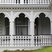 Alberton Historic House. Auckland. A Timber mansion began as a farmhouse in 1863 and was later expanded to 18 rooms, with fairy-tale decorative verandahs and towers. It was owned by the Kerr Taylors, a leading family in Mount Albert, until it was left to the New Zealand Historic Places Trust in 1972. Allan Kerr Taylor was a landowner, investor and provincial and local body politician. His wife Sophia was an outspoken advocate of the vote for women, as well as a singer, gardener and mother of 10. She ran the estate for 40 years after her husband's death, with her three unmarried daughters running it for a further 40 years..Alberton was famous in the 19th century for its balls, hunts, garden parties and music. It contains a wealth of original family furniture and other possessions, and several rooms retain their 19th century wallpapers. Alberton Historic House is situated in Mount Albert Road, Auckland, New Zealand.12th November 2010. Photo Tim Clayton..