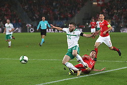 Northern Ireland's Stuart Dallas (left) and Switzerland's Stephan Lichtsteiner battle for the ball during the FIFA World Cup Qualifying second leg match at St Jakob Park, Basel.