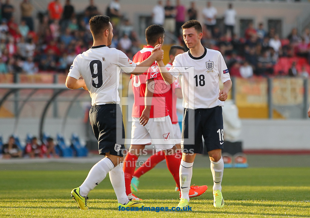 Patrick Roberts (right) of England celebrates scoring his sides third goal with his team mate Adam Armstrong (left) of England during the 2014 UEFA European Under-17 match at Ta' Qali National Stadium, Attard<br /> Picture by Tom Smith/Focus Images Ltd 07545141164<br /> 09/05/2014