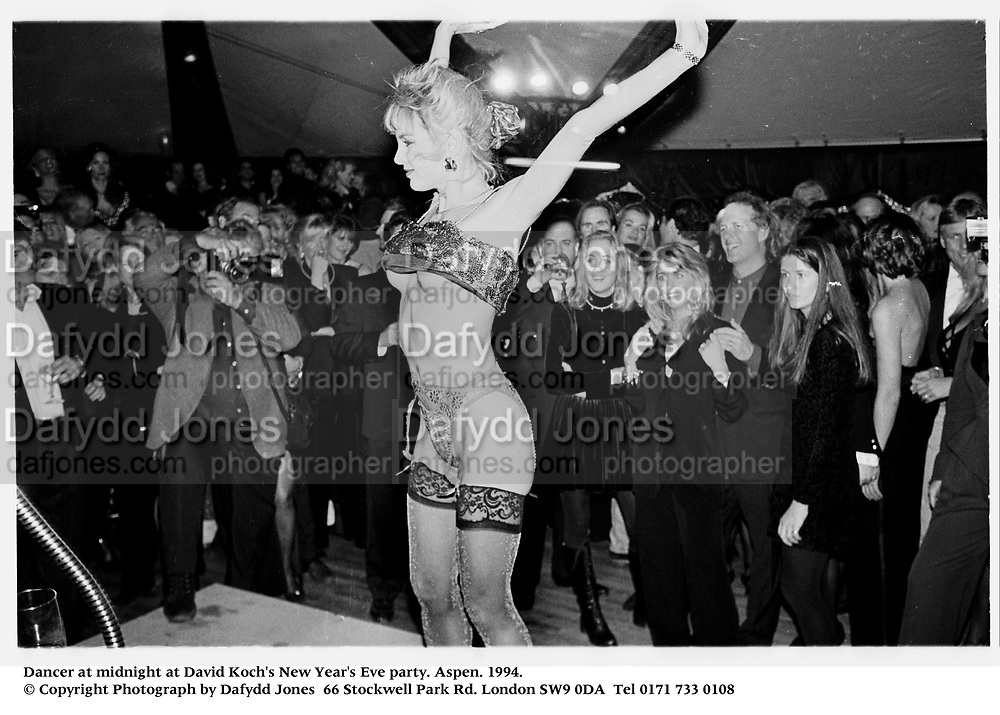 Dancer at midnight at David Koch's New Year's Eve party. Aspen. 1994.<br />