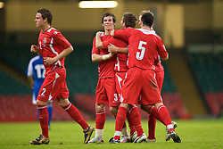 CARDIFF, WALES - Saturday, October 11, 2008: Wales' Ched Evans celebrates scoring the second goal against Liechtenstein with team-mates Gareth Bale and Craig Morgan during the 2010 FIFA World Cup South Africa Qualifying Group 4 match at the Millennium Stadium. (Photo by David Rawcliffe/Propaganda)