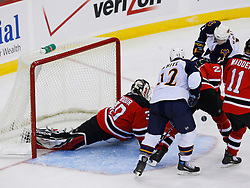 Nov 1, 2008; Newark, NJ, USA; New Jersey Devils goalie Martin Brodeur (30) injures his left arm making a save on Atlanta Thrashers center Todd White (12) during the second period at the Prudential Center.