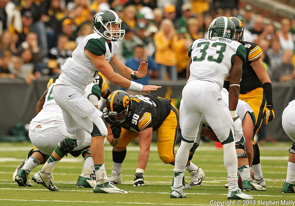 October 6 2013: Michigan State Spartans quarterback Connor Cook (18) signals his team at the line during the first quarter of the NCAA football game between the Michigan State Spartans and the Iowa Hawkeyes at Kinnick Stadium in Iowa City, Iowa on October 6, 2013. Michigan State defeated Iowa 26-14.