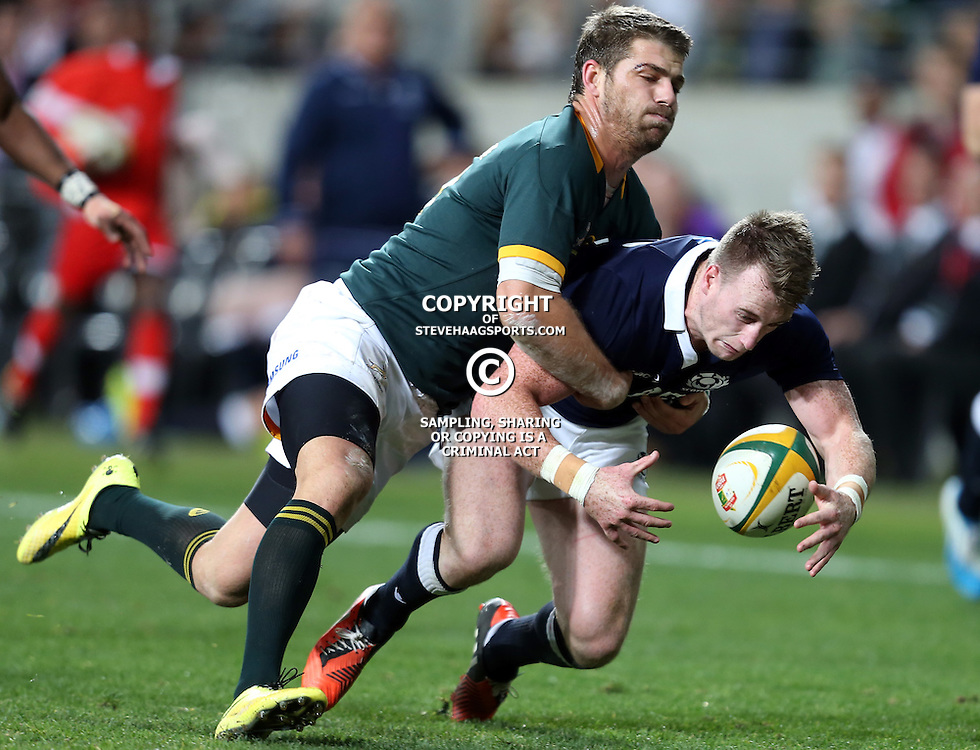 PORT ELIZABETH, SOUTH AFRICA - JUNE 28: Willie le Roux of South Africa with a tackle on Stuart Hogg of Scotland during the Incoming Tour match between South Africa and Scotland at Nelson Mandela Bay Stadium on June 28, 2014 in Port Elizabeth, South Africa. (Photo by Steve Haag/Gallo Images)