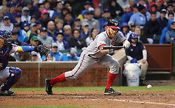 October 11, 2017 - Chicago, IL, USA - Washington Nationals pitcher Stephen Strasburg lays down a successful sacrifice bunt along the first base line in the fourth inning against the Chicago Cubs in Game 4 of the National League Division Series at Wrigley Field in Chicago on Wednesday, Oct. 11, 2017. (Credit Image: © Brian Cassella/TNS via ZUMA Wire)