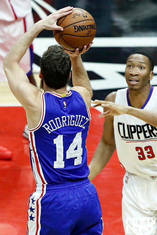 11 March 2017: Philadelphia 76ers guard Sergio Rodriguez (14) takes a jump shot over LA Clippers forward Wesley Johnson (33) during the LA Clippers 112-100 victory over the Philadelphia Sixers, at the Staples Center, Los Angeles, California, USA.