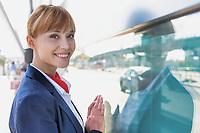 Portrait of smiling young attractive flight attendant in airport