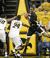 26 NOVEMBER 2007: Wake Forest guard Jeff Teague (0) grabs a rebound in front of Iowa forward Jarryd Cole (50) and guard Justin Johnson (24) in Wake Forest's 56-47 win over Iowa at Carver-Hawkeye Arena in Iowa City, Iowa on November 26, 2007.