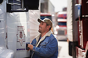 19 DECEMBER 2008 -- NOGALES, SON, MEX: A Mexican trucker climbs into the cab of his truck while waiting to enter the US on the Mexican side of the Mariposa port of Entry in Nogales.  PHOTO BY JACK KURTZ