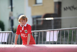 A young Bristol City fan wearing the new 14/15 shirt looks on - Photo mandatory by-line: Dougie Allward/JMP - Mobile: 07966 386802 11/07/2014 - SPORT - FOOTBALL - Bristol - Ashton Gate - Bristol City Fan Friday