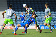 Isaiah Osbourne challenges Joe Rafferty during the EFL Sky Bet League 1 match between Rochdale and Walsall at Spotland, Rochdale, England on 25 August 2018.