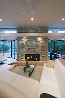 Sunken seating area and exposed stone fireplace of Palm Springs home