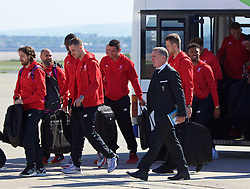 LIVERPOOL, ENGLAND - Monday, May 16, 2016: Liverpool's Joe Allen, captain Jordan Henderson, Chief Executive Officer Ian Ayre and Jordon Ibe board their plane to Basel as they fly out of Liverpool John Lennon Airport to Switzerland ahead of the UEFA Europa League Final against Sevilla FC. (Pic by David Rawcliffe/Propaganda)