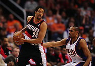 Apr 26, 2010; Phoenix, AZ, USA; Portland Trailblazers guard Andre Miller (24) is guarded by Phoenix Suns forward Grant Hill (33) during the second quarter in game five in the first round of the 2010 NBA playoffs at the US Airways Arena.  Mandatory Credit: Jennifer Stewart-US PRESSWIRE