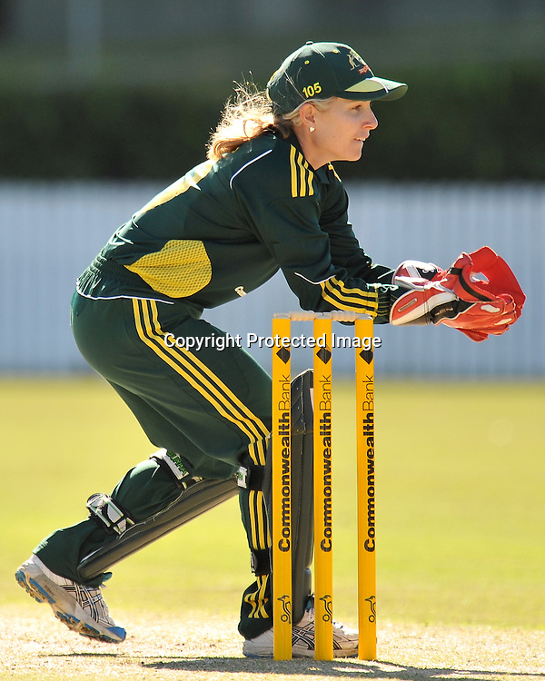 Jodie Fields watchs the ball into her gloves during action in Game 6 (ODI) of the Rose Bowl Trophy Cricket played between Australia and New Zealand at Alan Border Field in Brisbane (Australia) ~ Monday 14May 2011 ~ Photo : Steven Hight (AURA Images) / Photosport