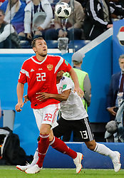 June 19, 2018 - Saint Petersburg, Russia - Artem Dzyuba (L) of Russia national team and Mohamed Abdelshafy of Egypt national team vie for the ball during the 2018 FIFA World Cup Russia group A match between Russia and Egypt on June 19, 2018 at Saint Petersburg Stadium in Saint Petersburg, Russia. (Credit Image: © Mike Kireev/NurPhoto via ZUMA Press)