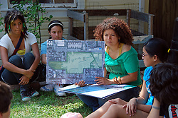 USA, Chicago, August 25, 2009.   Youth Coordinator Lillian Molina shows participants in a local leadership program a park plan for the Celotex site, possible home for much-needed open space. The Little Village Environmental Justice Organization, headquartered in a predominantly Mexican-American neighborhood of Chicago, campaigns not only against pollution but for clean power, park facilities, urban agriculture, and restoring public transit. LVEJO's staff and volunteers make significant outreach and education efforts, especially for youth. Photo for an HOY feature story by Jay Dunn.