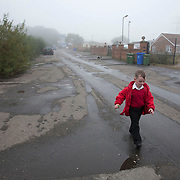 An Irish traveller resident at Dale Farm on his way to school days before the eviction is going ahead. As a result of the eviction by Basildon council in Essex, many children will be forced to leave the school to live on the road.September 2011 Basildon UK