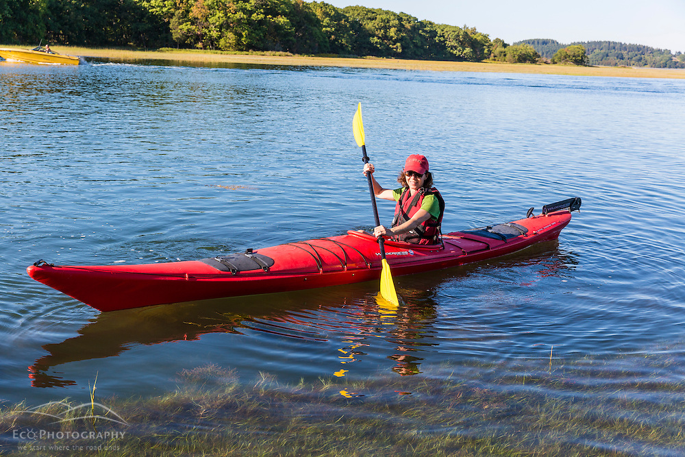 A kayaker on the Essex River at the Cox Reservation in Essex, Massachusetts.