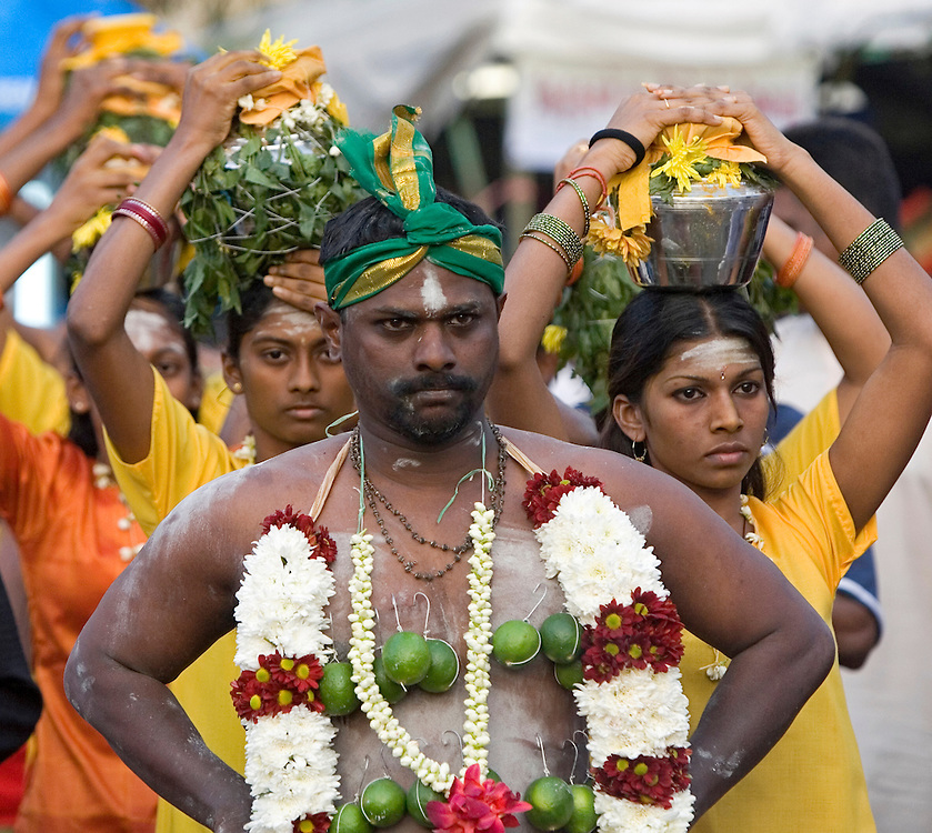 "Hindu devotees walks to the sacred Batu Caves temple during the Thaipusam festival in Kuala Lumpur, Malaysia. Hindu devotees celebrate Thaipusam festival in honour of the Lord Murugan (also known as Lord Subramaniam). Thousands of Hindu devotees carried the milk pots and ""kavadi"" (a gaily decorated wooden or metal frame) walk barefoot up the temple's 272 steps to undergo penance in fulfilling vows made to Lord Murugan for answering their prayers."