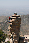 Rock climbers scale the General Hitchcock Monument at Windy Point Vista on Mount Lemmon, Santa Catalina Mountains, Coronado National Forest, Sonoran Desert, Tucson, Arizona, USA.