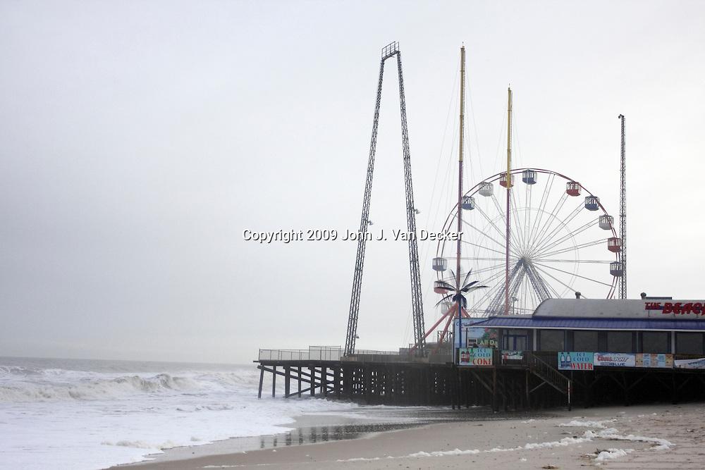 Seaside Heights boardwalk with ferris wheel immediately after Hurricane Ida
