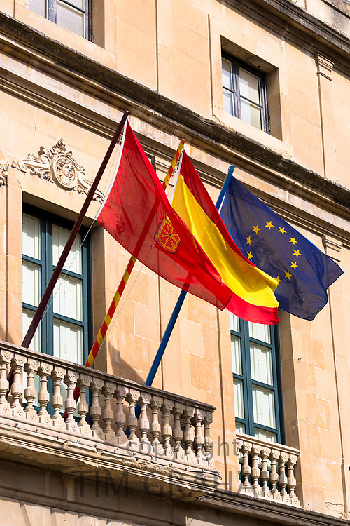 Left to Right Pamplona, Spanish and European Union EU flags on public building in Pamplona, Navarre, Northern Spain
