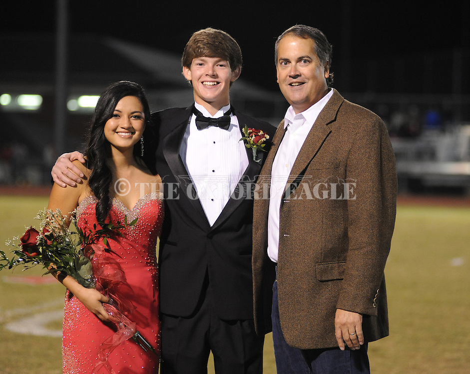 Junior maid Brandy Batoon (left), escorted by Pittman Phillips at Oxford High vs. Saltillo in Oxford, Miss. on Friday, October 19, 2012. Oxford won to improve to 9-0.