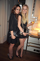 Left to right, KIERSTON WAREING and CLARA PAGET at a dinner hosted by designer Pauric Sweeney held in The Postilion Roon, The Langham, ondon on 23rd June 2009.