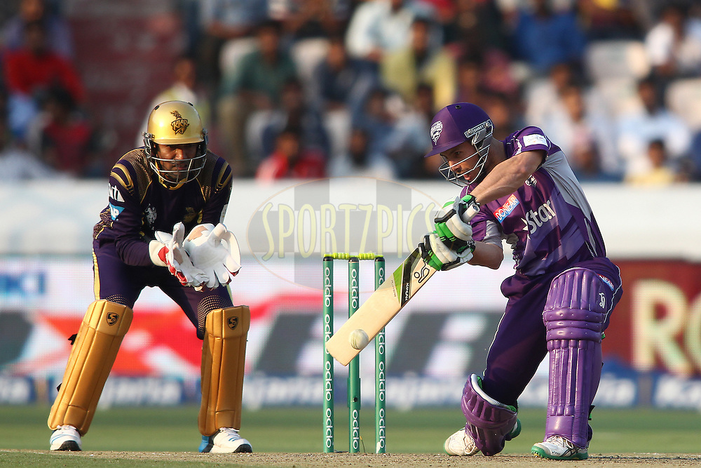 Jon Wells of the Hobart Hurricanes square cuts a delivery during the first semi final match of the Oppo Champions League Twenty20 between the Kolkata Knight Riders and the Hobart Hurricanes held at the Rajiv Gandhi Cricket Stadium, Hyderabad, India on the 2nd October 2014<br /> <br /> Photo by:  Shaun Roy / Sportzpics/ CLT20<br /> <br /> <br /> Image use is subject to the terms and conditions as laid out by the BCCI/ CLT20.  The terms and conditions can be downloaded here:<br /> <br /> http://sportzpics.photoshelter.com/gallery/CLT20-Image-Terms-and-Conditions-2014/G0000IfNJn535VPU/C0000QhhKadWcjYs