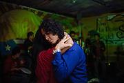 A couple dances inside a nightclub in Ciudad Nezahualcoyotl, March 12, 2011.