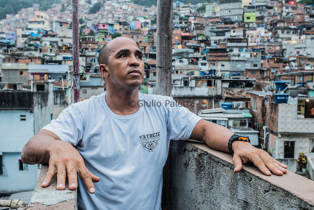 "Claudio ""Pamonha"", 47, surfer. We luckily ran into him on Sunday. He represents the second generation of Rocinha surfers, and is a well-known guy among every kind of resident. His reputation over there makes him important during the challenge of unifying surfers and bodyboarders on the battle to save the wave. He's a middle-aged guy with a teenage spirit. His respect throughout the community – even from drug dealers – gave us access to places where he claims no other journalist has ever been before, such as Lajão, where residents discharge usually throw solid trash away onto the ditch and it starts getting critical – the place is really close to criminal organization's headquarters."