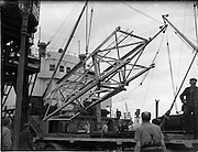 """31/07/1962<br /> 07/31/1962<br /> 31 July 1962<br /> Oil drilling equipment arrives at North Wall, Dublin. Image shows unloading of oil drilling machinery for Ambassador Irish oil. The equipment is being loaded onto CIE trucks  from the ship """"Kendall""""."""