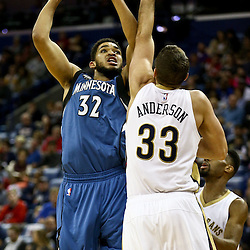 Feb 27, 2016; New Orleans, LA, USA; Minnesota Timberwolves center Karl-Anthony Towns (32) shoots over New Orleans Pelicans forward Ryan Anderson (33) during the first half of a game at  the Smoothie King Center. Mandatory Credit: Derick E. Hingle-USA TODAY Sports