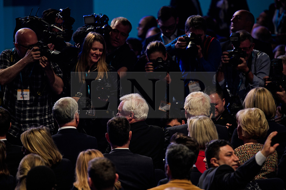 © Licensed to London News Pictures. 04/10/2017. Manchester, UK. Media watch as MICHAEL FALLON, DAVID DAVIS BORIS JOHNSON and AMBER RUDD   arrive in the conference hall to listen to prime minister THERESA MAY deliver her leaders speech on the final day of the Conservative Party Conference. The four day event is expected to focus heavily on Brexit, with the British prime minister hoping to dampen rumours of a leadership challenge. Photo credit: Ben Cawthra/LNP