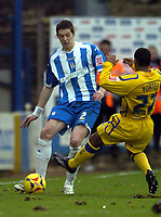 Photo: Olly Greenwood.<br />Colchester United v Leicester City. Coca Cola Championship. 13/01/2007. Leicester's Levi Porter tackles Colchester's Greg Halford