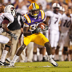 November 13, 2010; Baton Rouge, LA, USA; LSU Tigers wide receiver Terrence Toliver (80) catches a pass in front of Louisiana Monroe Warhawks cornerback Otis Peterson (9) during the first half at Tiger Stadium.  Mandatory Credit: Derick E. Hingle