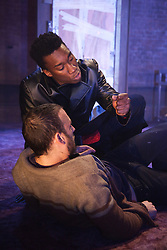 """© Licensed to London News Pictures. 30/01/2012. London, England. Nathan Stewart-Jarrett, top, and Chris New, bottom, performing. """"The Pitchfork Disney"""", a searing, disturbing vision of fear, sexuality and the effects of random violence written by Philip Ridley opens at the Arcola Theatre, Hackney. Directed by Edward Dick. Photo credit: Bettina Strenske/LNP"""