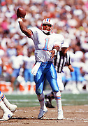 Houston Oilers quarterback Warren Moon (1) throws a pass during the 1990 NFL regular season football game against the San Diego Chargers on Sept. 29, 1990 in San Diego. The Oilers won the game 17-7. (©Paul Anthony Spinelli)