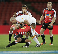 JOHANNESBURG, SOUTH AFRICA - 23 April 2011: Michael Rhodes and Burton Francis of the Lions tackle Aled de Malmanche of the Chiefs during the Super Rugby Match between the MTN Lions and the Chiefs held at Coca Cola Park Stadium, Johannesburg, South Africa. Photo by Dominic Barnardt