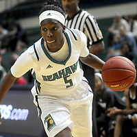 UNCW's Shatia Cole drives against UNCP Sunday November 16, 2014 at Trask Coliseum in Wilmington, N.C. (Jason A. Frizzelle)