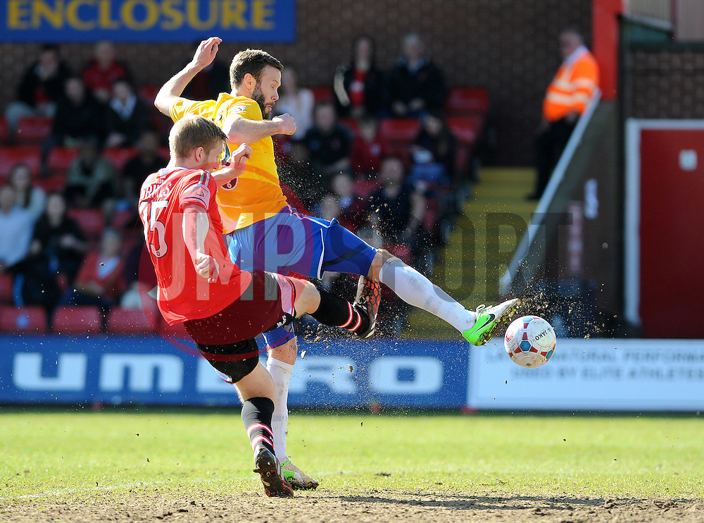 Bristol Rovers' Andy Monkhouse is challenged by Kidderminster Harriers's Jamie Grimes - Photo mandatory by-line: Neil Brookman/JMP - Mobile: 07966 386802 - 06/04/2015 - SPORT - Football - Kidderminster - Aggborough - Kidderminster v Bristol Rovers - Vanarama Football Conference