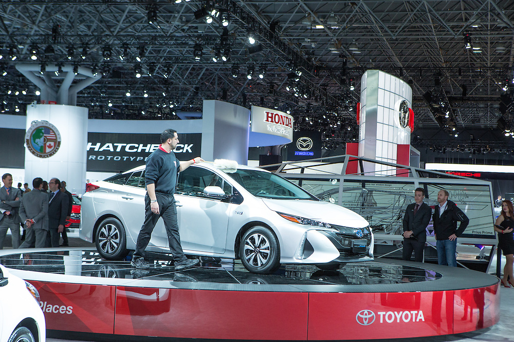 New York, NY, USA-23 March 2016. A worker dusting a Toyota Prius Prime, a hybrid which they expect to have on the market in August, 2016.