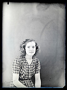 vintage studio portrait of a young adult woman looking at the camera 1930s